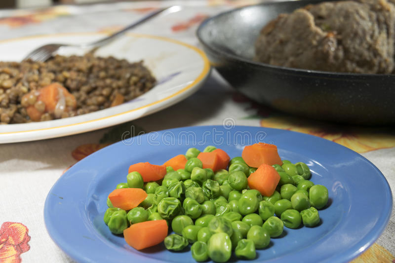 Steamed peas with carrots royalty free stock photos