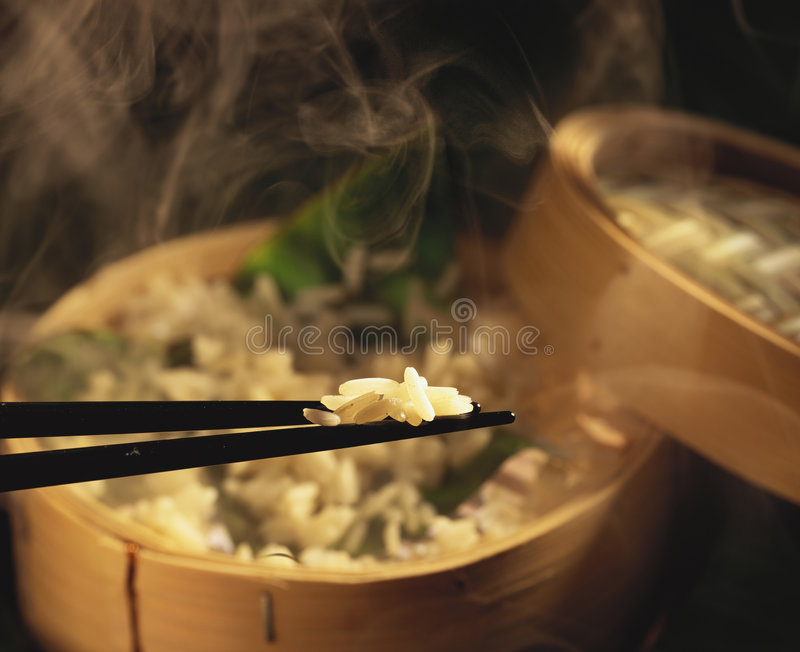 Steamed Rice. In a bamboo basket stock photography