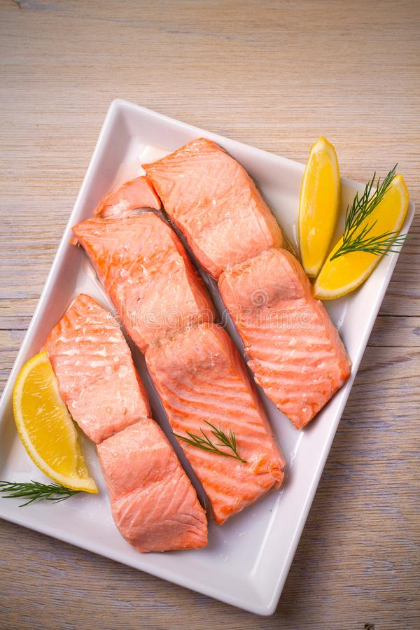 Steamed salmon fish fillet on white plate. Clean eating, healthy and diet food concept. royalty free stock image