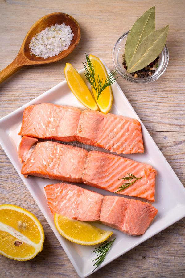 Steamed salmon fish fillet on white plate. Clean eating, healthy and diet food concept. royalty free stock photography
