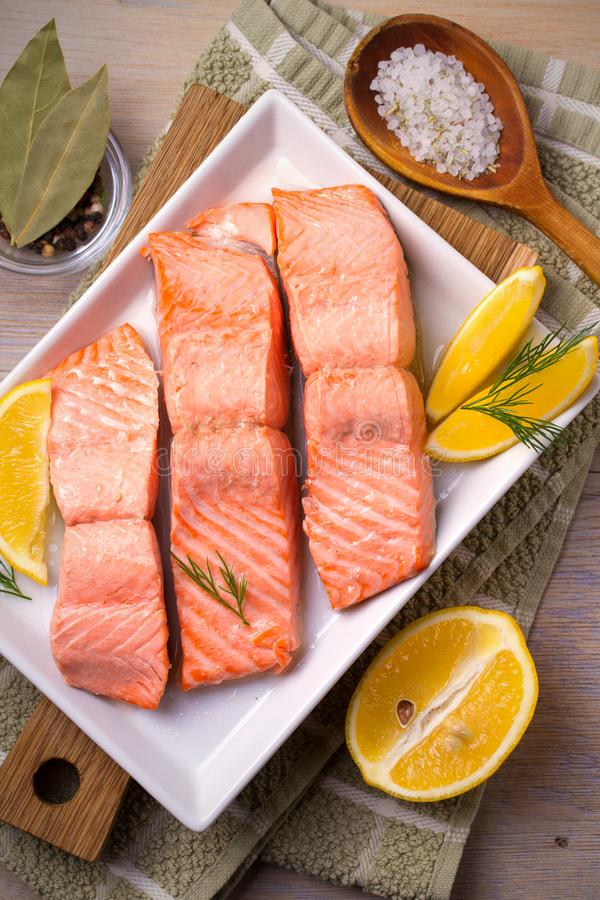 Steamed salmon fish fillet on white plate. Clean eating, healthy and diet food concept. royalty free stock photos