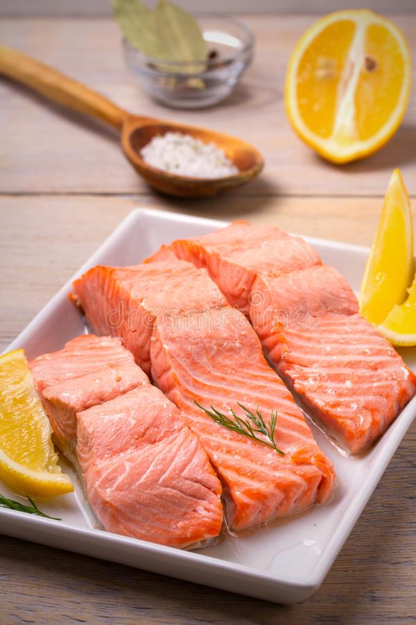 Steamed salmon fish fillet on white plate. Clean eating, healthy and diet food concept. stock images