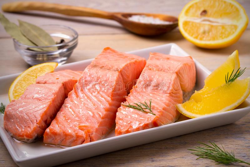 Steamed salmon fish fillet on white plate. Clean eating, healthy and diet food concept. royalty free stock images