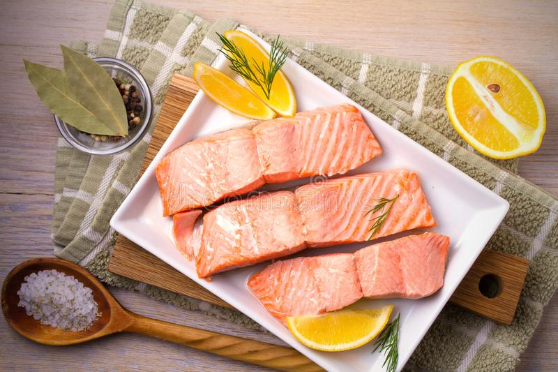 Steamed salmon fish fillet on white plate. Clean eating, healthy and diet food concept. stock photography