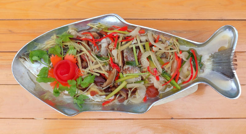 Steamed sea-bass with spicy lemon sauce, tasty Thai food. Steamed sea-bass with spicy lemon sauce, tasty Thai food dishes stock image