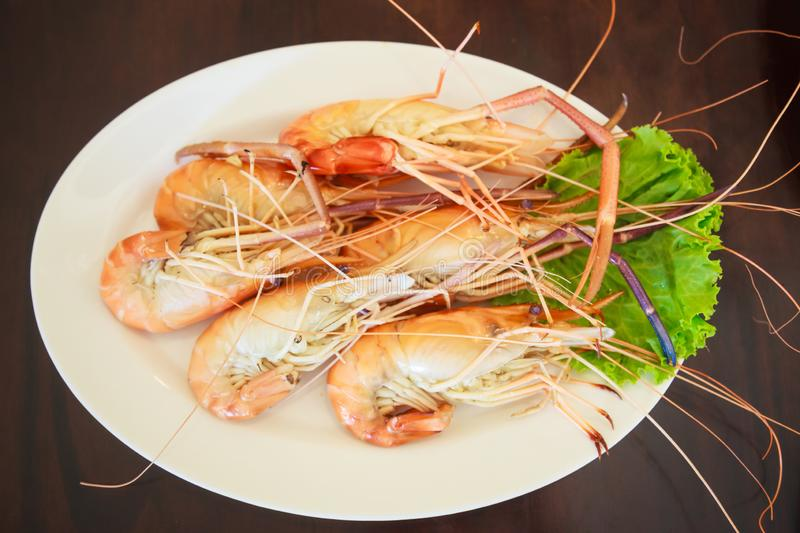Steamed Seafood from sea market, Fresh Tasty Appetizing Cooked Tiger Prawns on Wooden Table Background. Food, Nutrition, Allergy, stock photos