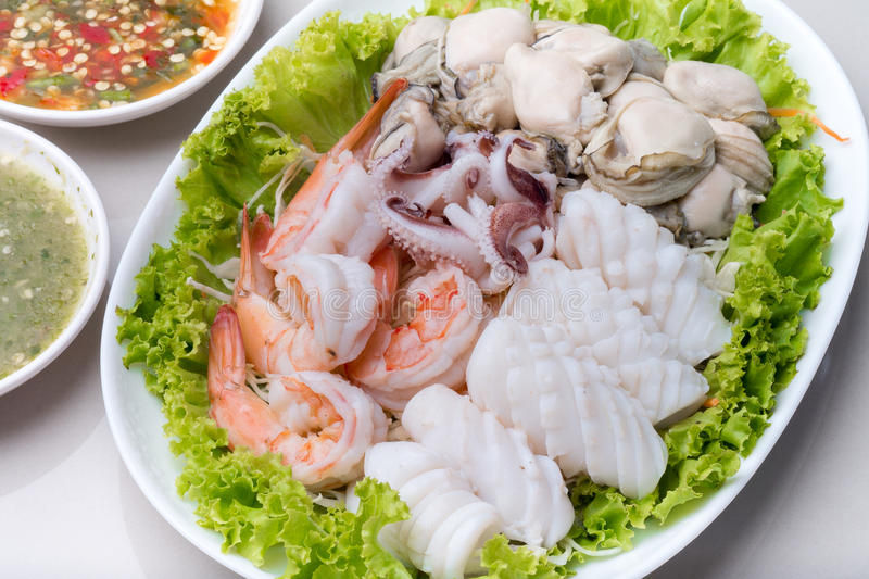 Steamed shrimp and squid and raw oyster stock photos