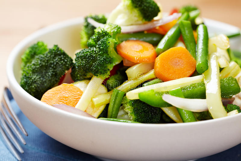 Steamed vegetables in a bowl. Closeup of various steamed vegetables in a bowl royalty free stock photos