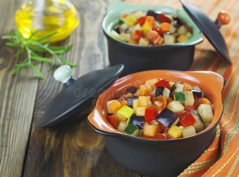 Steamed vegetables in pots portioned royalty free stock photos