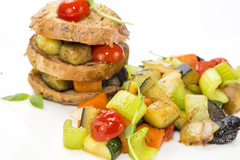 Steamed vegetables. And rye bread royalty free stock photo
