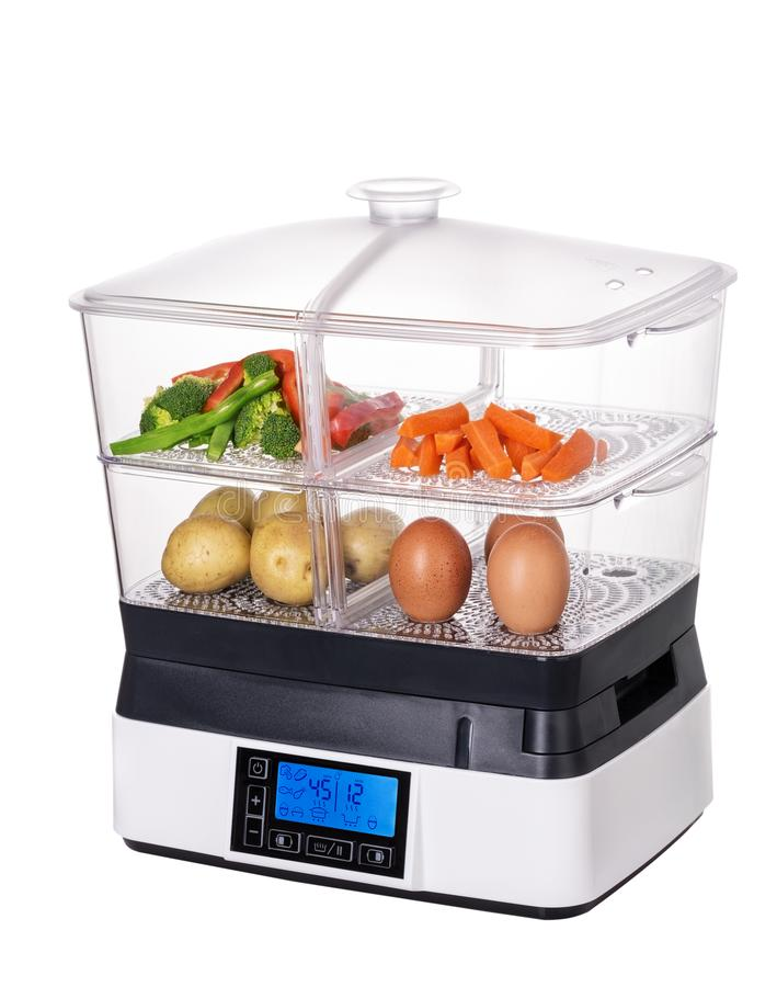 Steamer for vegetables and healthy food. Vegetarianism. Double boiler royalty free stock image