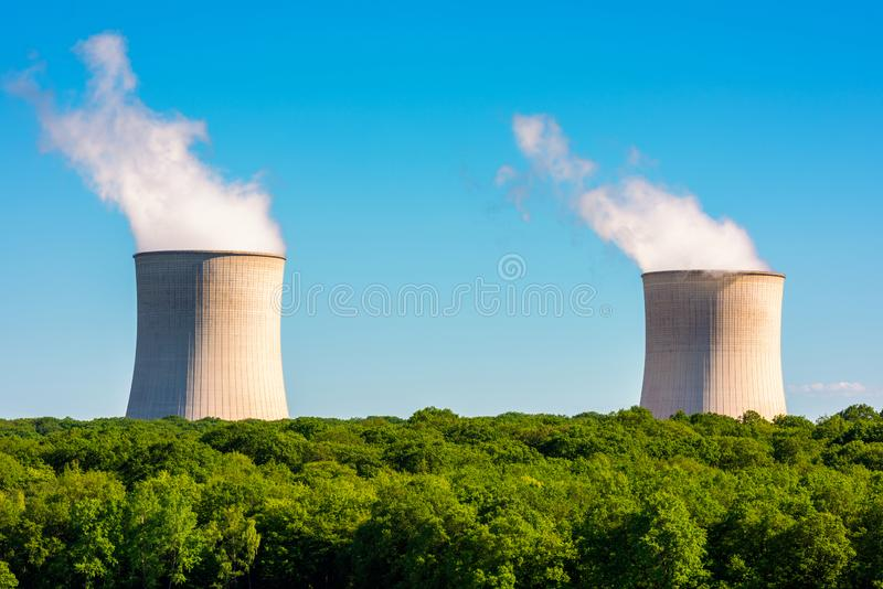 Steaming Cooling Towers at Nuclear Power Plant. Steaming Cooling Towers at Cattenom Nuclear Power Plant in Northeastern France stock image