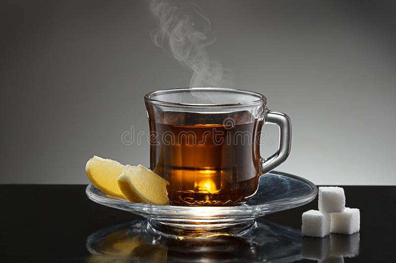 Steaming cup of hot tea. stock photo