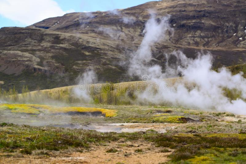 Steaming geothermal hot water Iceland royalty free stock image