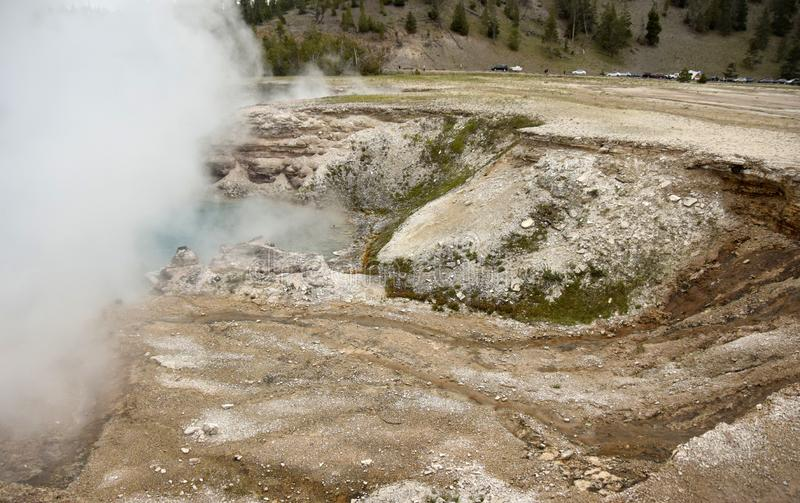 Steaming geothermal vents in Wyoming. Geothermal lakes and steam in Yellowstone, Wyoming, USA stock photography