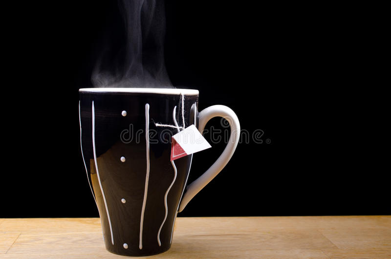 Download Steaming hot cup of tea stock image. Image of dark, black - 22237581