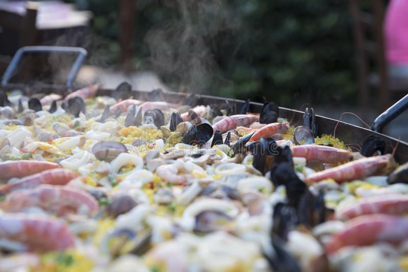 Steaming paella stock photography