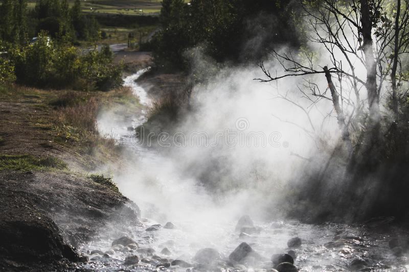 Steaming river in iceland sunshine, near Geysir royalty free stock photos