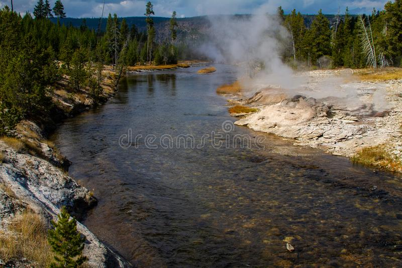 Steaming Riverbank in Yellowstone. A steaming riverbank along the meandering waters in the beautiful landscape of Yellowstone National Park, Wyoming royalty free stock image