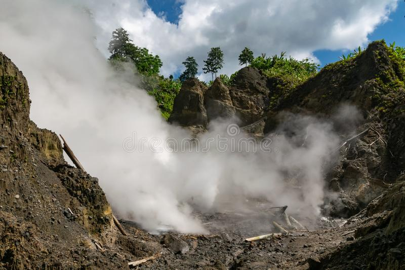 Steaming rushing from ground in Colo volcano, Indonesia. Crater of the active stratovolcano Colo located in Una Una island, Sulawesi royalty free stock photos