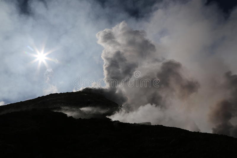 Steaming Volcano etna in Sicily in the morning sun. Volcano etna in Sicily with steam emission in the morning sun stock photography