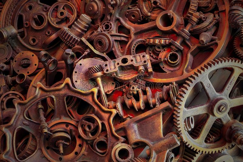 Steampunk background, machine and mechanical parts, large gears and chains from machines and tractors. Steampunk background, machine parts, large gears and royalty free stock photo