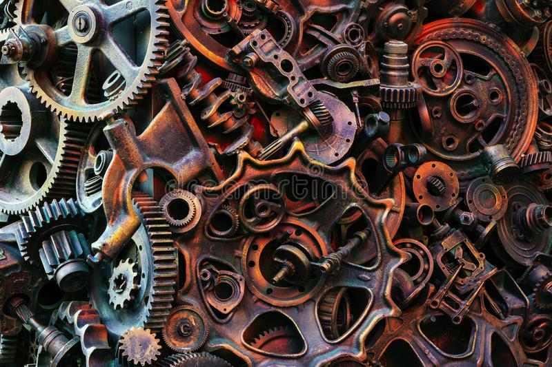 Steampunk background, machine and mechanical parts, large gears and chains from machines and tractors. royalty free stock images