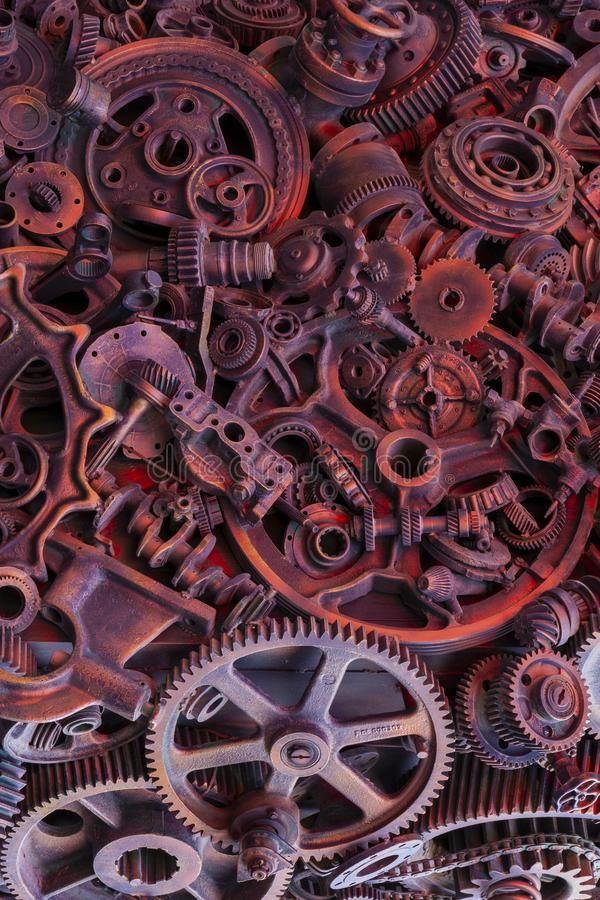 Steampunk background, machine parts, large gears and chains from machines and tractors. Old rusty machine parts. Springs, bearings, pistons, crankshafts stock image