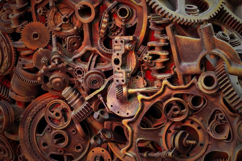 Steampunk background, machine parts, large gears and chains from machines and tractors. Old rusty machine parts. Springs, bearings, pistons, crankshafts royalty free stock images