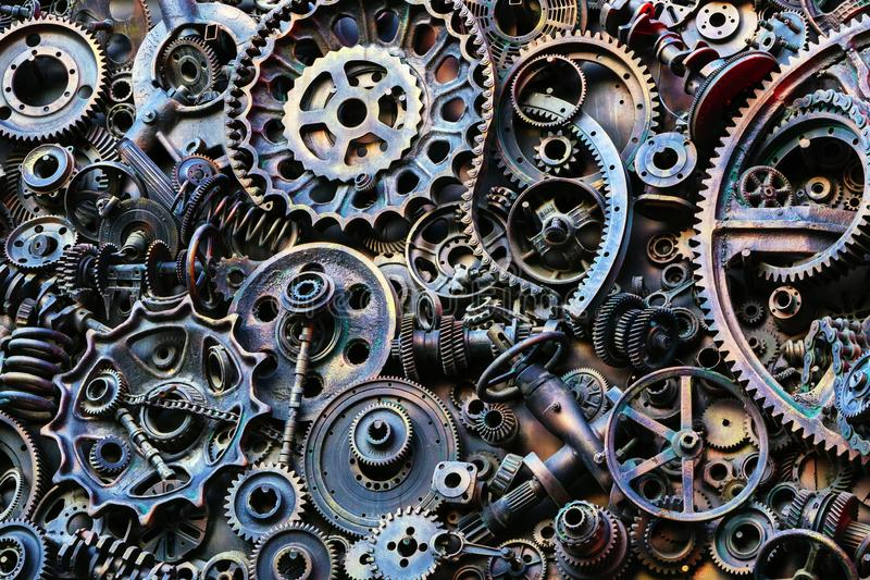 Steampunk background, machine parts, large gears and chains from machines and tractors. Old rusty machine parts. Springs, bearings, pistons, crankshafts stock images