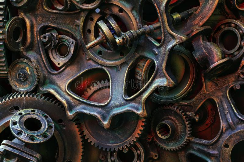 Steampunk background, machine parts, large gears and chains from machines and tractors. Old rusty machine parts. Springs, bearings, pistons, crankshafts royalty free stock photos