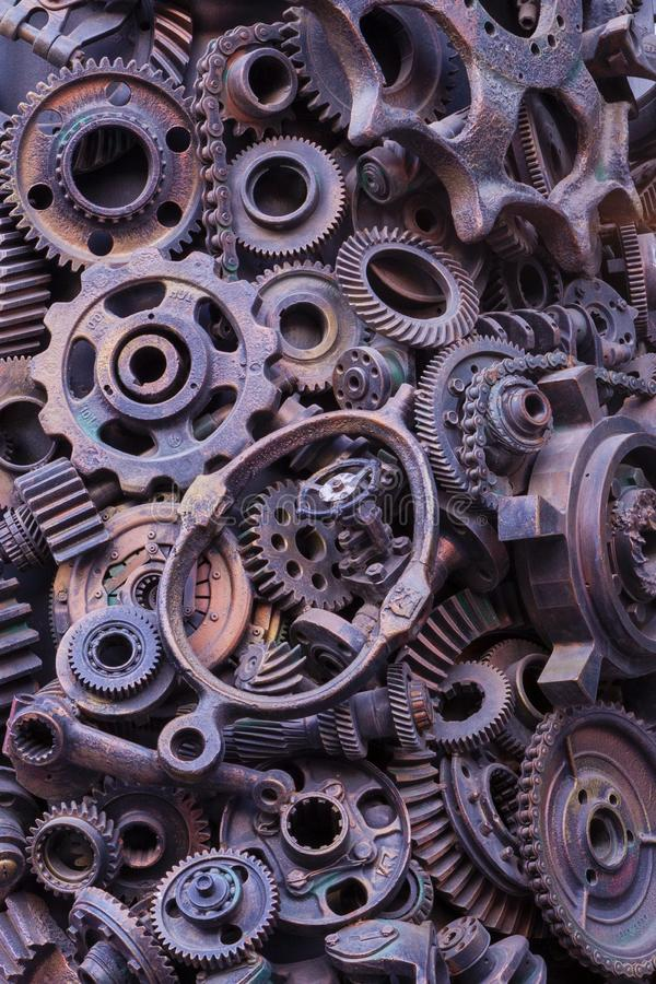 Steampunk background, machine parts, large gears and chains from machines and tractors. Old rusty machine parts. Springs, bearings, pistons, crankshafts royalty free stock photography