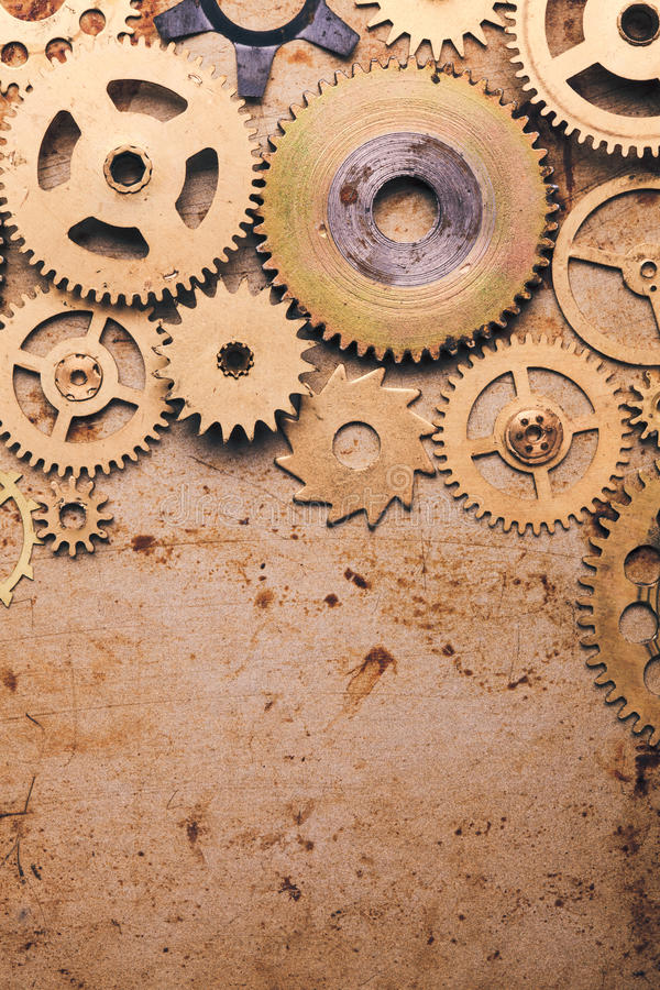 Steampunk background. From mechanical clocks details over old metal background. Inside the clock, gears royalty free stock photo