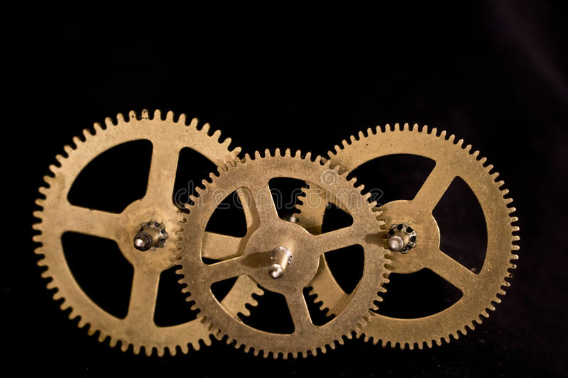 Steampunk Clock Cogs on Black Background. Close up of Steampunk Clock Cogs on Black Background stock image