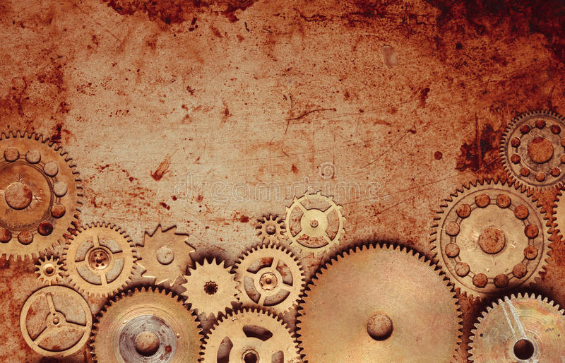 Steampunk gears background. Steampunk background from mechanical clocks details over old metal background. Inside the clock, gears stock images