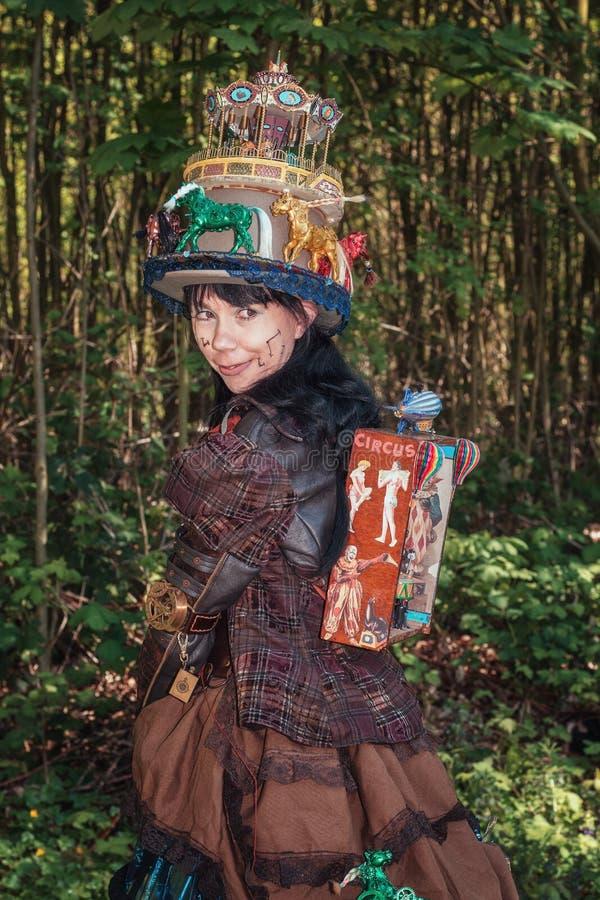 Steampunk girl decorated with circus and fun fair attributes during the Elf Fantasy Fair stock photos