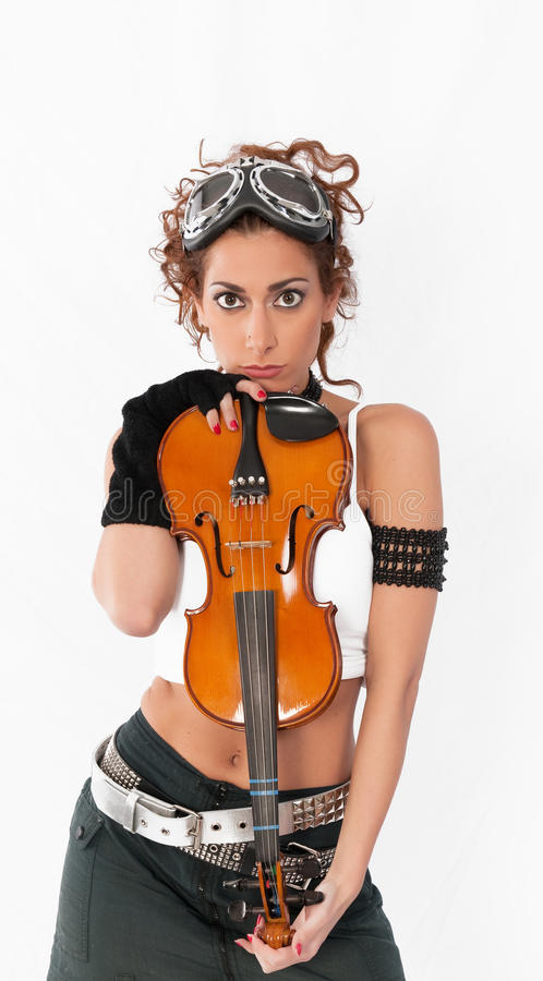 Steampunk girl with goggles and violin. royalty free stock photos