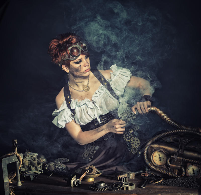 Steampunk girl. Portrait of a steam-punk girl in the workshop royalty free stock image