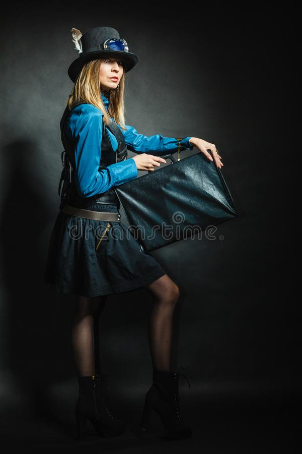 Steampunk girl with retro bag stock images