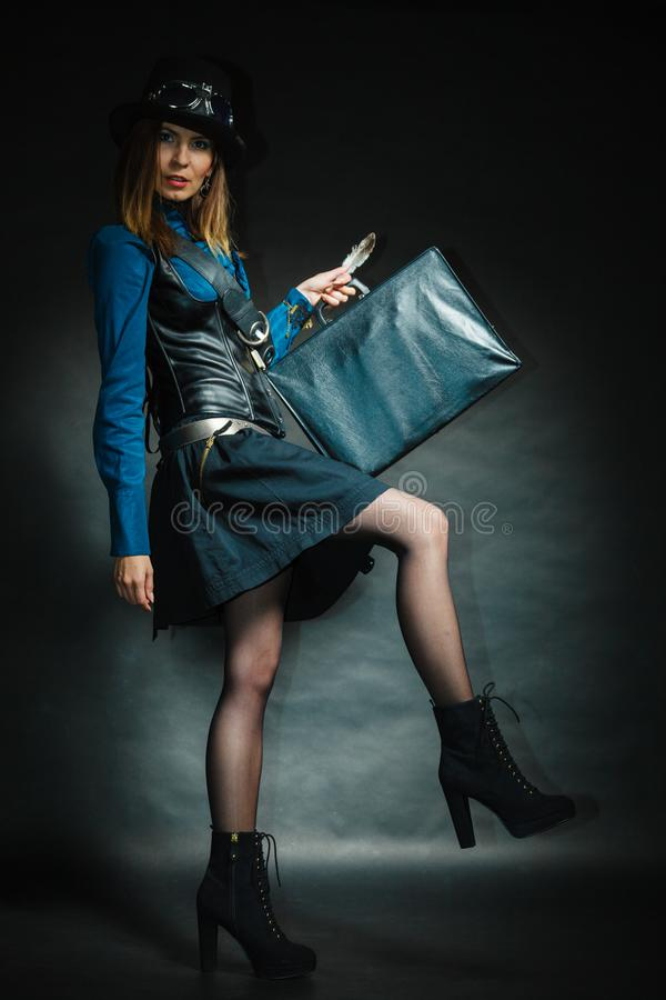 Steampunk girl with retro bag royalty free stock photography