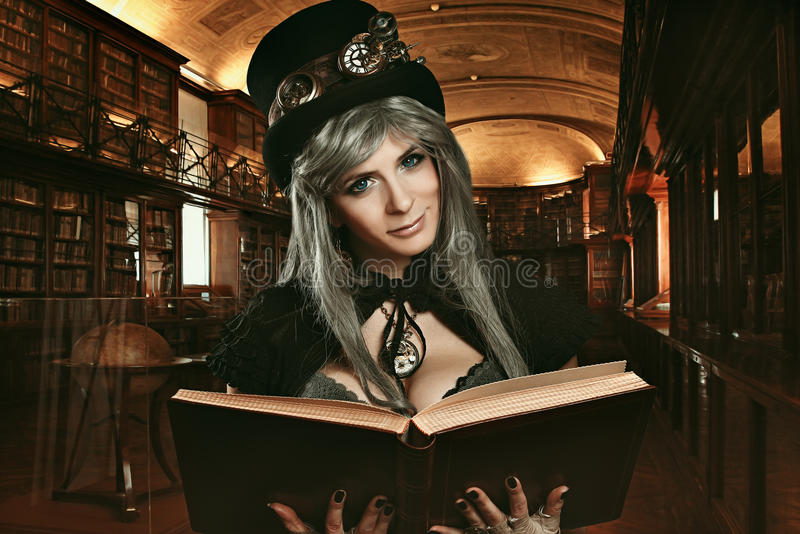 Steampunk girl in the royal library royalty free stock photo