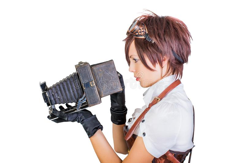 Steampunk girl in vintage corset with retro camera royalty free stock image