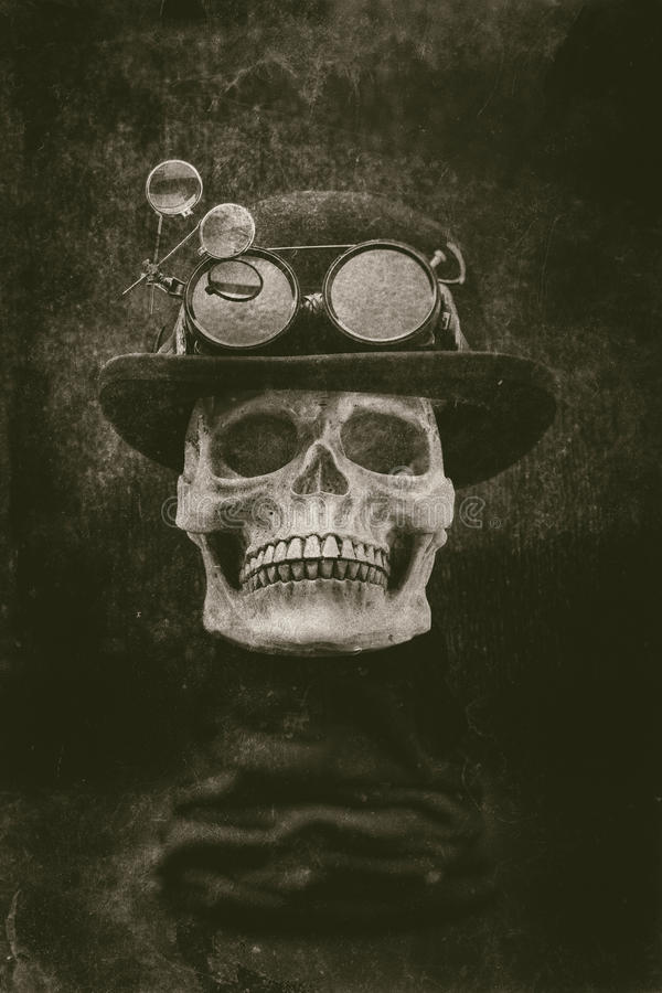 Steampunk halloween skull with bowler hat and goggles grunge eff stock photography