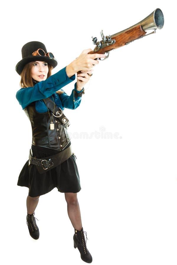 Steampunk-Mädchen mit Gewehr stockfotos