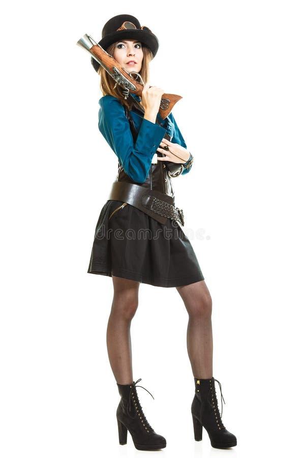 Steampunk-Mädchen mit Gewehr stockbild