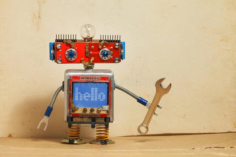 Steampunk machinery robot, smiley red head, blue monitor body. Handyman electrician retro toy, message hello display stock photo