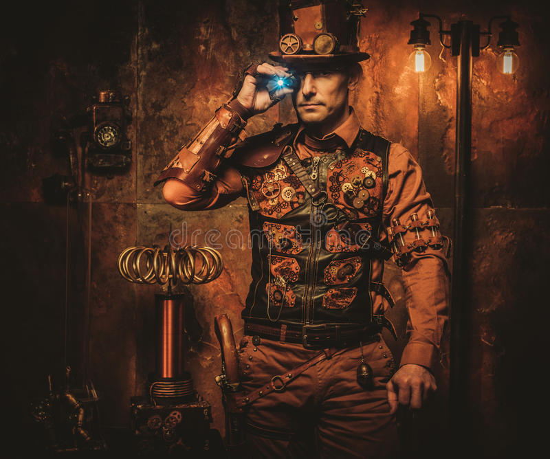 Steampunk man with gun on vintage steampunk background.  royalty free stock image