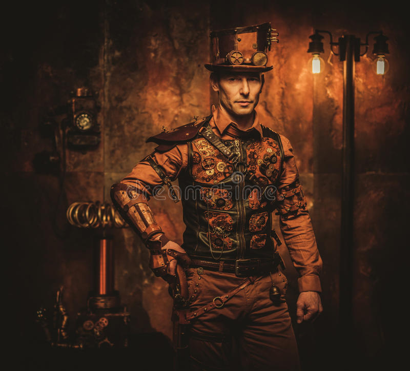 Steampunk man with gun on vintage steampunk background.  stock photos
