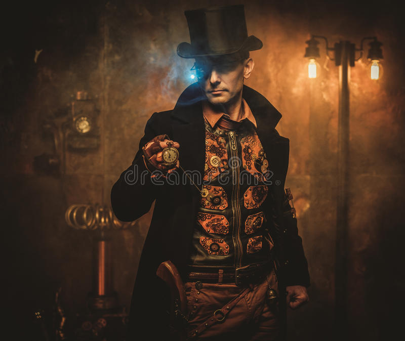 Steampunk man with pocket watch on vintage steampunk background.  royalty free stock photography