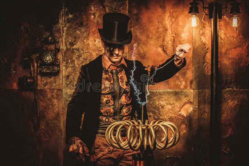 Steampunk man with Tesla coil on vintage steampunk background.  stock photo